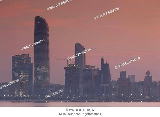 UAE, Abu Dhabi, city skyline along the Corniche, dawn