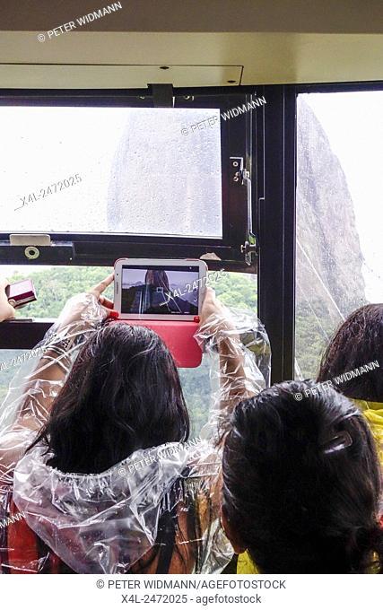Cable car ride, rain, tourist, Sugar Loaf, Rio de Janiero, Brazil, Rio de Janeiro