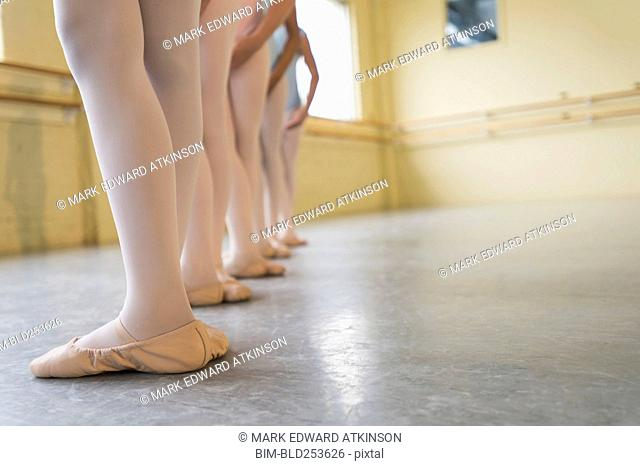 Legs of girls in ballet studio
