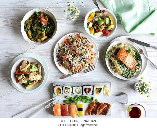 Teriyaki salmon, Vietnamese salad, sushi, two chicken dishes and a fruit salad
