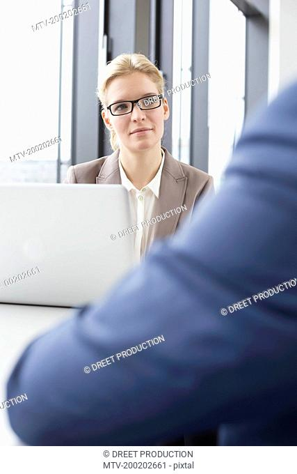 Colleagues having counseling interview in office