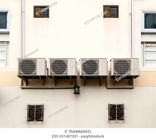 Old air conditioner group is hanging on the office building