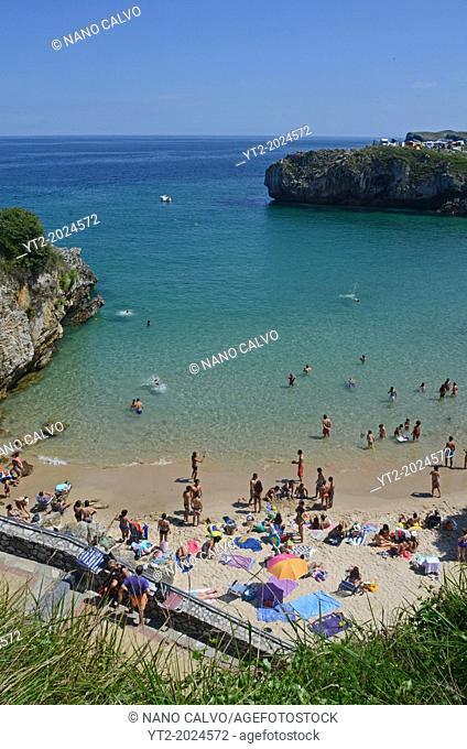 Summer day on a beach in Llanes, Asturias, Spain