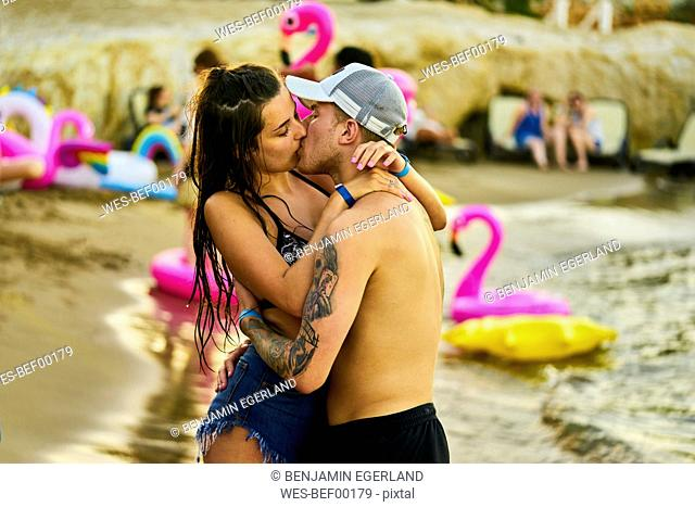 Greece, Crete, passionate lovers kissing at beach party