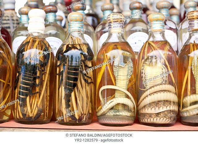Laotian rum with snakes on display at a market stall in Luang Prabang, Laos