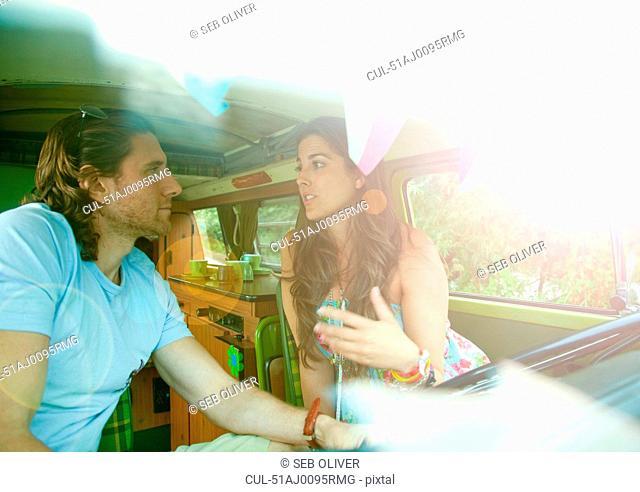 Couple talking in trailer