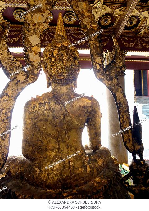 Back view of the head of a Buddha statue that has been decorated with donated leaf gold at Wat Benchamabophit inBangkok,Thailand, 04 March 2016