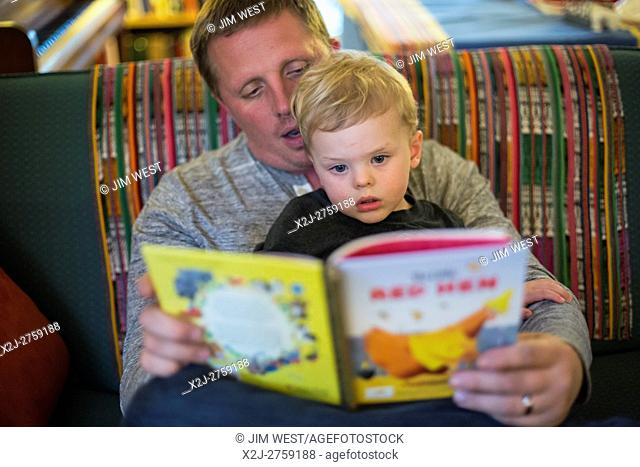 Detroit, Michigan - Adam Hjermstad reads to his two-year-old son, Adam Hjermstad Jr