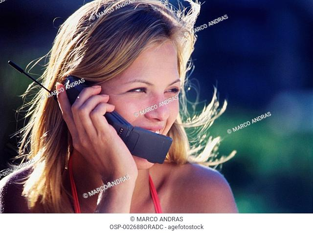 a blond girl talking on her cellphone
