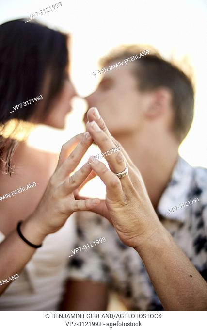 Sensual couple touching fingers, love, emotions, relationship, flirting. Chersonissos, Crete, Greece