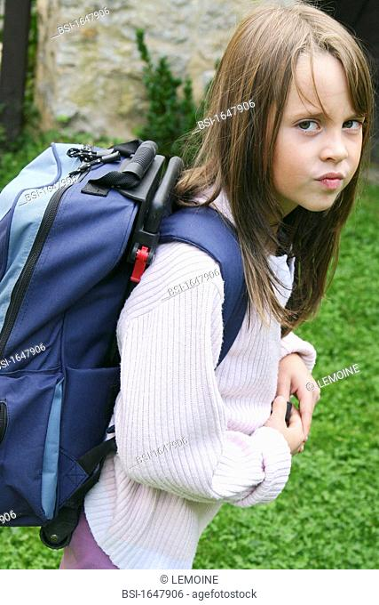 10-year-old girl. Illustration of back pain related to carrying a too heavy school bag