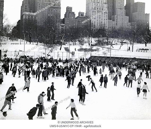 New York, New York: c. 1952 Ice skaters throng to the Park for skating fun at the 59th Street rink on a winter's day in Manhattan's Central Park