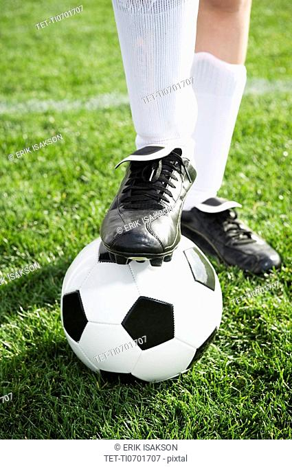 Close up of boy's foot on soccer ball