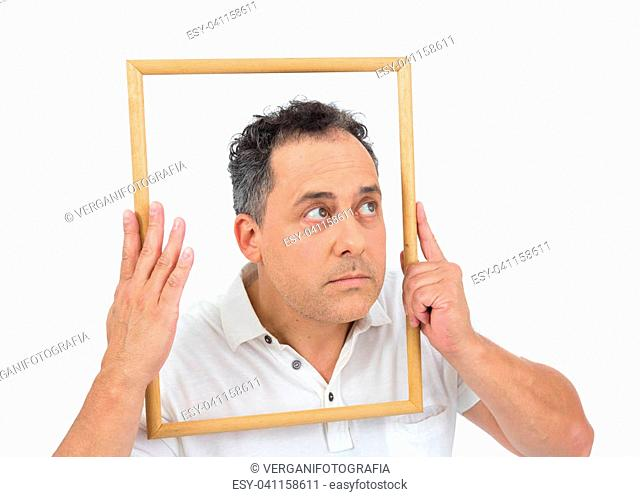 Funny artist is looking through the frame of the picture. Man with overweight is wearing white polo. Isolated on white background