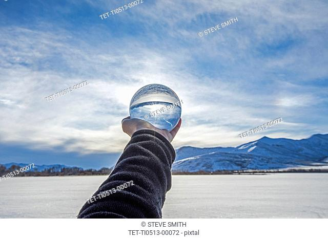Hand of man holding glass orb in Picabo, Idaho