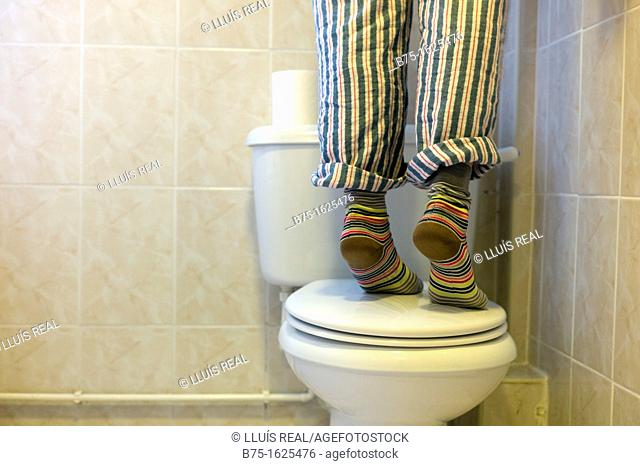 Person standing on toilet