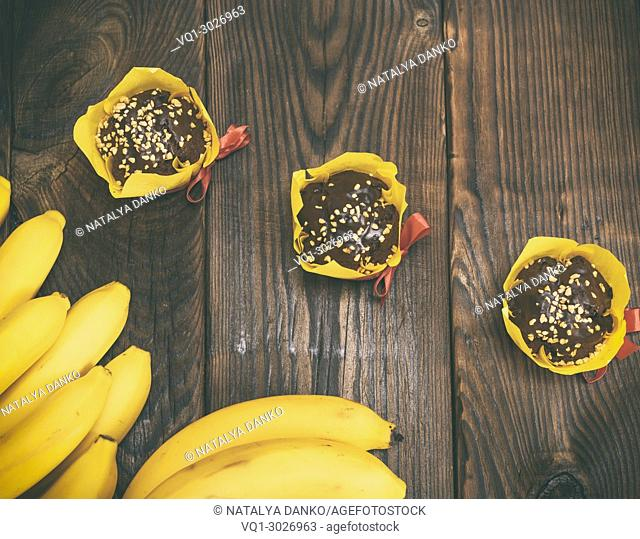 chocolate muffins with a banana, top view