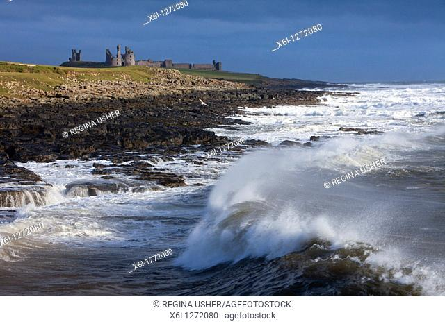 Dunstanburgh Castle, with stormy North Sea, autumn, Northumberland, England
