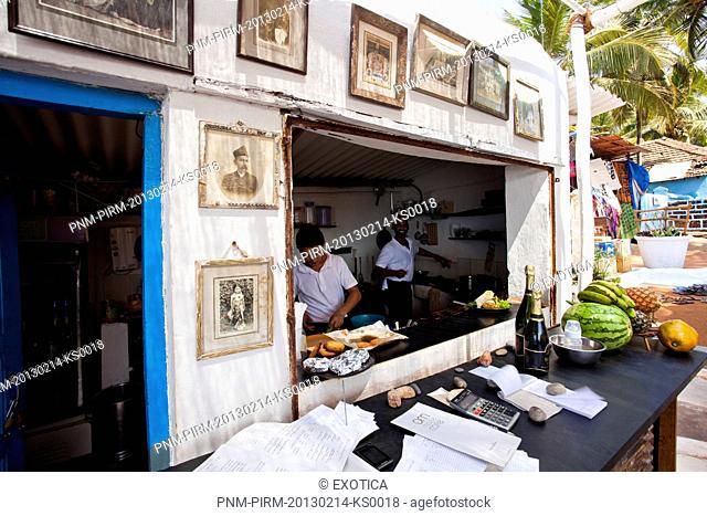Chefs preparing food in a restaurant, Om Made Cafe, Anjuna, North Goa, Goa, India