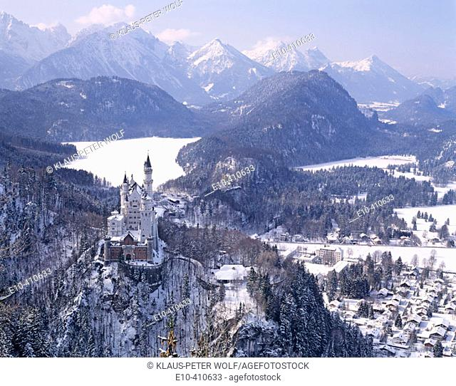 The castle Neuschwanstein in front of the snow covered Alpsee near Füssen. Germany