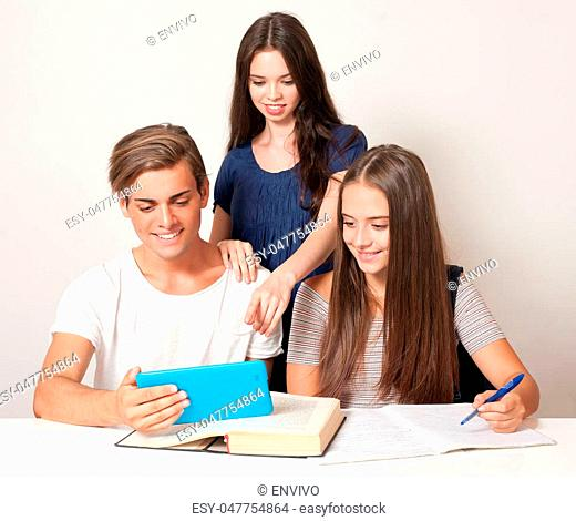 Three happy relaxed high school students