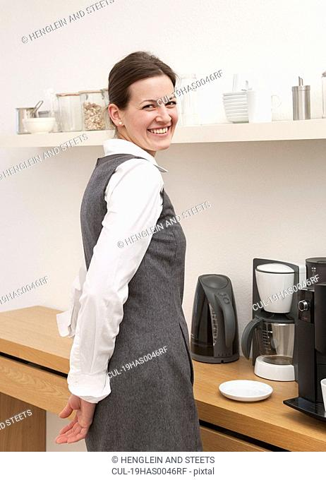 Businesswoman in coffee kitchen