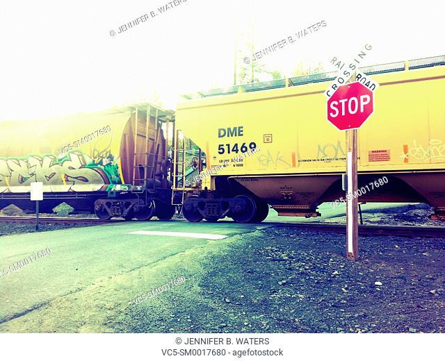 A train crossing a road in Spokane, Washington, USA