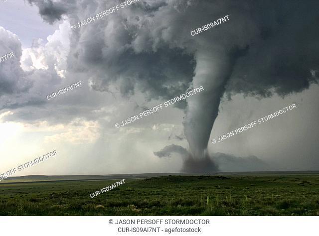 This tornado demonstrates Barber Poling: the rotational bands twisting around the tornado itself, Campo, Colorado, USA