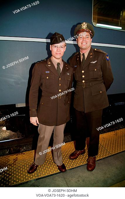 Two 1940's male soldiers pose in front of Pearl Harbor Day Troop train reenactment from Los Angeles Union Station to San Diego