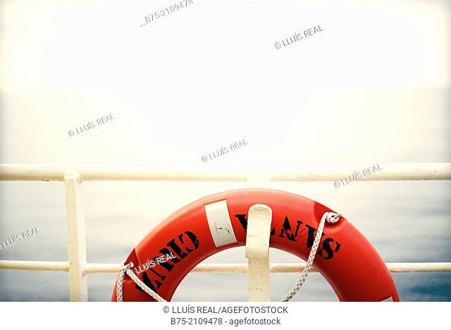 Railing of a boat with a lifeguard. Croosing the Mediterranean Sea from Ciutadella, Menorca to Alcudia, Mallorca, Balearic Islands, Spain