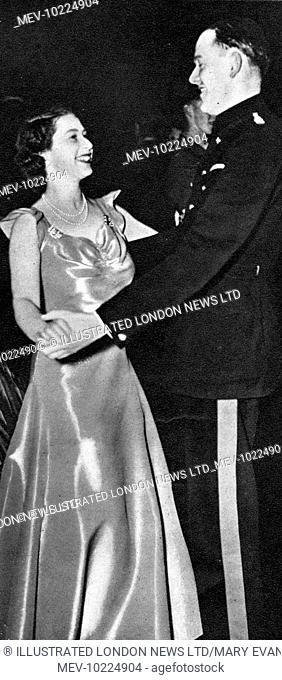 H.R.H. Princess Elizabeth dancing with Captain Joshua Rayley, Grenadier Guards at a ball in aid of the N.S.P.C.C. at the Old House Hotel, Windsor