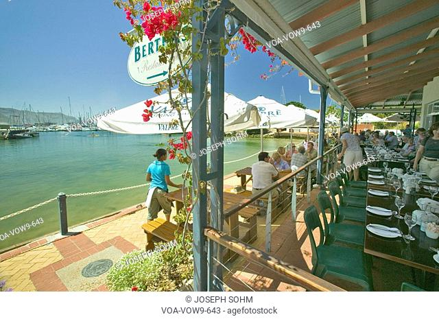 Outdoor seafood restaurant on bay of Simon's Town, outside of Cape Town on Indian Ocean at False Bay, South Africa