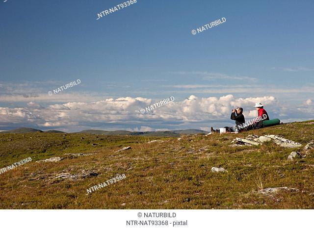 Couple having break during hiking