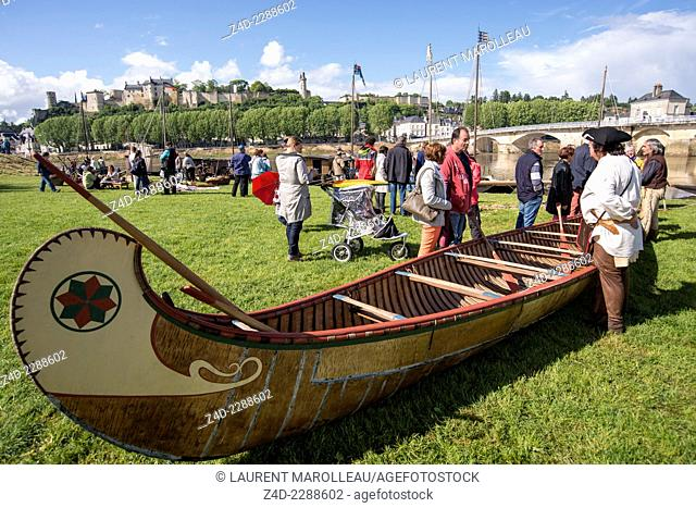 Birch bark canoe. Chinon Boats festival (La fête de la Batellerie) with traditional flat-bottomed wooden boats called toues