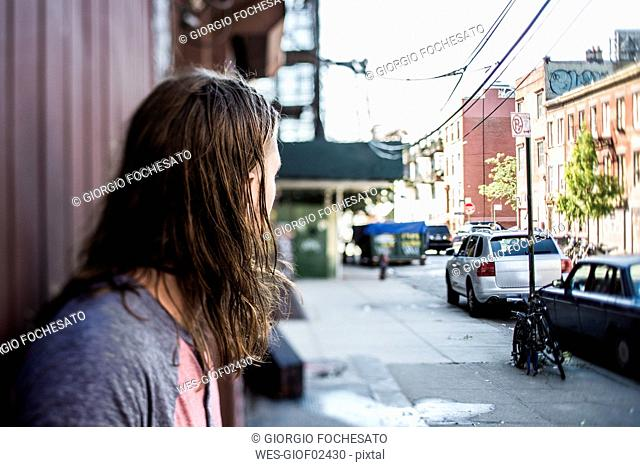 USA, New York City, man looking around in Williamsburg, Brooklyn