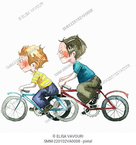 Two boys speeding on bicycles