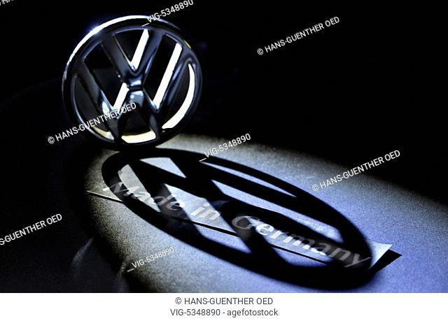 27.10.2015, Unkel, GER, Germany, Symbol photo, the VW emblem casts a large dark shadow on the lettering Made in Germany - Unkel, Rhineland-Pala, Germany