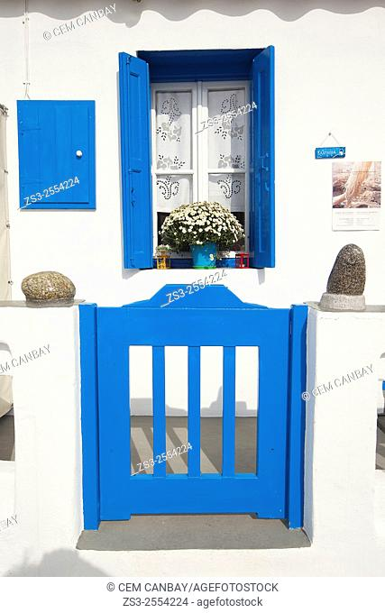 Whitewashed house with blue window and door in town center, Mykonos, Cyclades Islands, Greek Islands, Greece, Europe