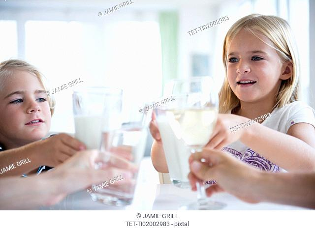 Family with son (4-5) and daughter (6-7) drinking refreshments