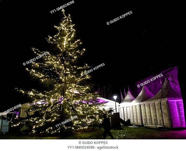 Tilburg, Netherlands. Party Tent with Illuminated Christmas Tree just a week before the hollidays. Large organisations, like Tilburg University
