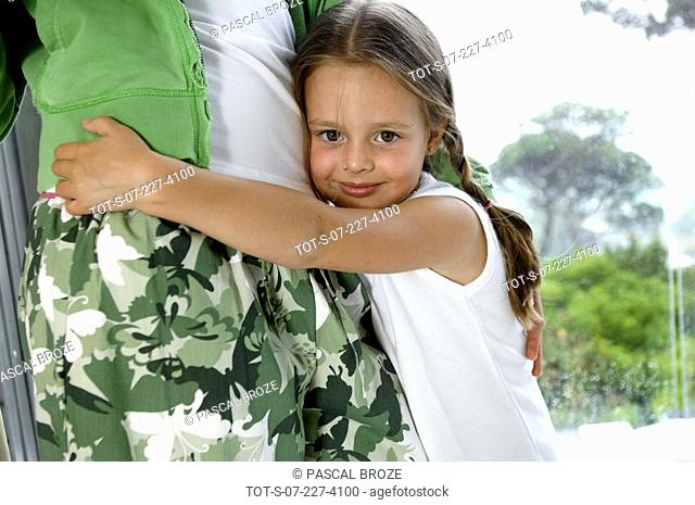 Portrait of a girl hugging her mother