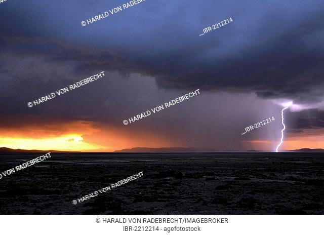 Stormy sky at sunset with lightning, Salar de Uyuni, Lipez, Bolivia, South America