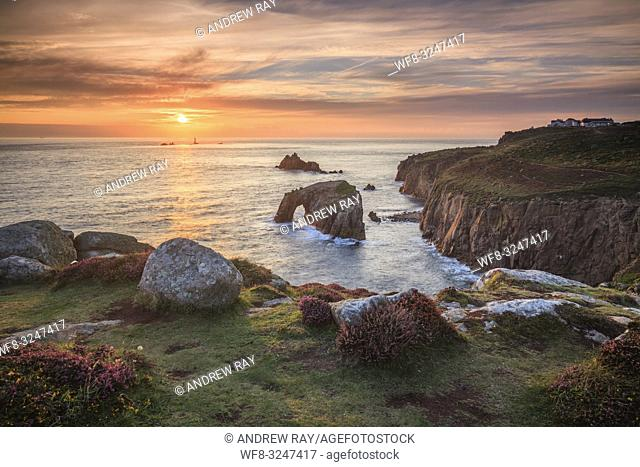The setting sun captured from Pordenack Point, near Land's End in Cornwall on an evening in late