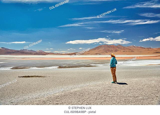 Woman standing, looking at view, Laguna Colorada, Colorada, Potosi, Bolivia, South America