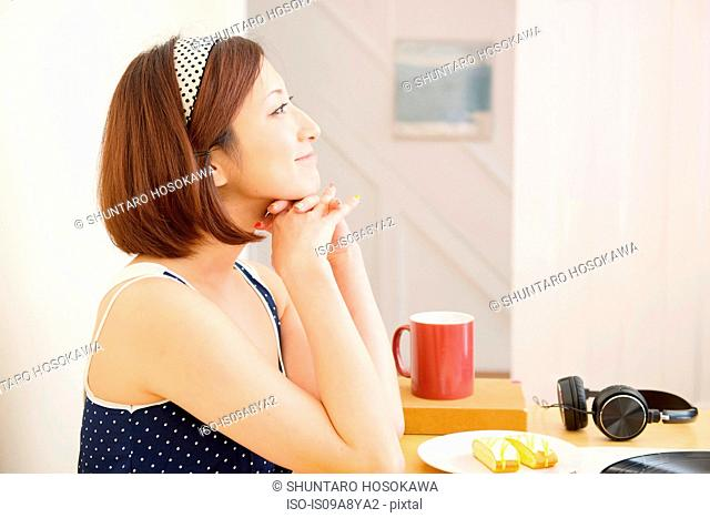 Woman looking into distance smiling