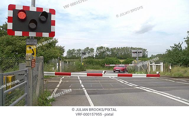 The Barriers lift at an automatic level crossing, allowing traffic to pass