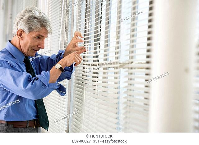 A business man looking out from a window