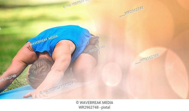 Man performing yoga in park