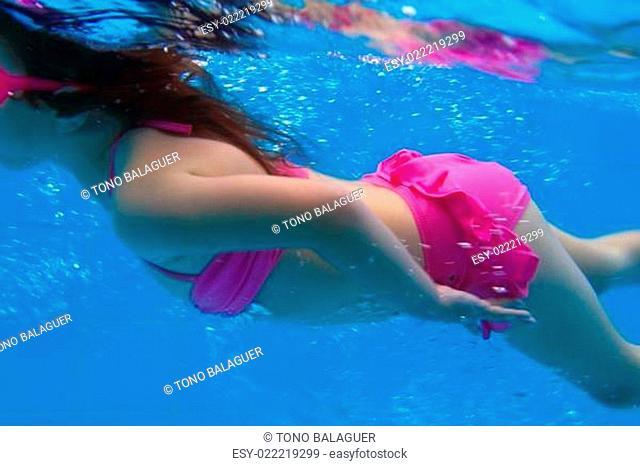 underwater pink bikini little girl swimming in pool