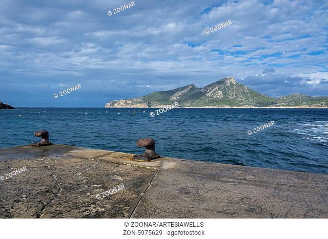 Two rusty knobs on Sant Elm quay, view to Dragonera, Majorca. Mallorca, Balearic islands, Spain